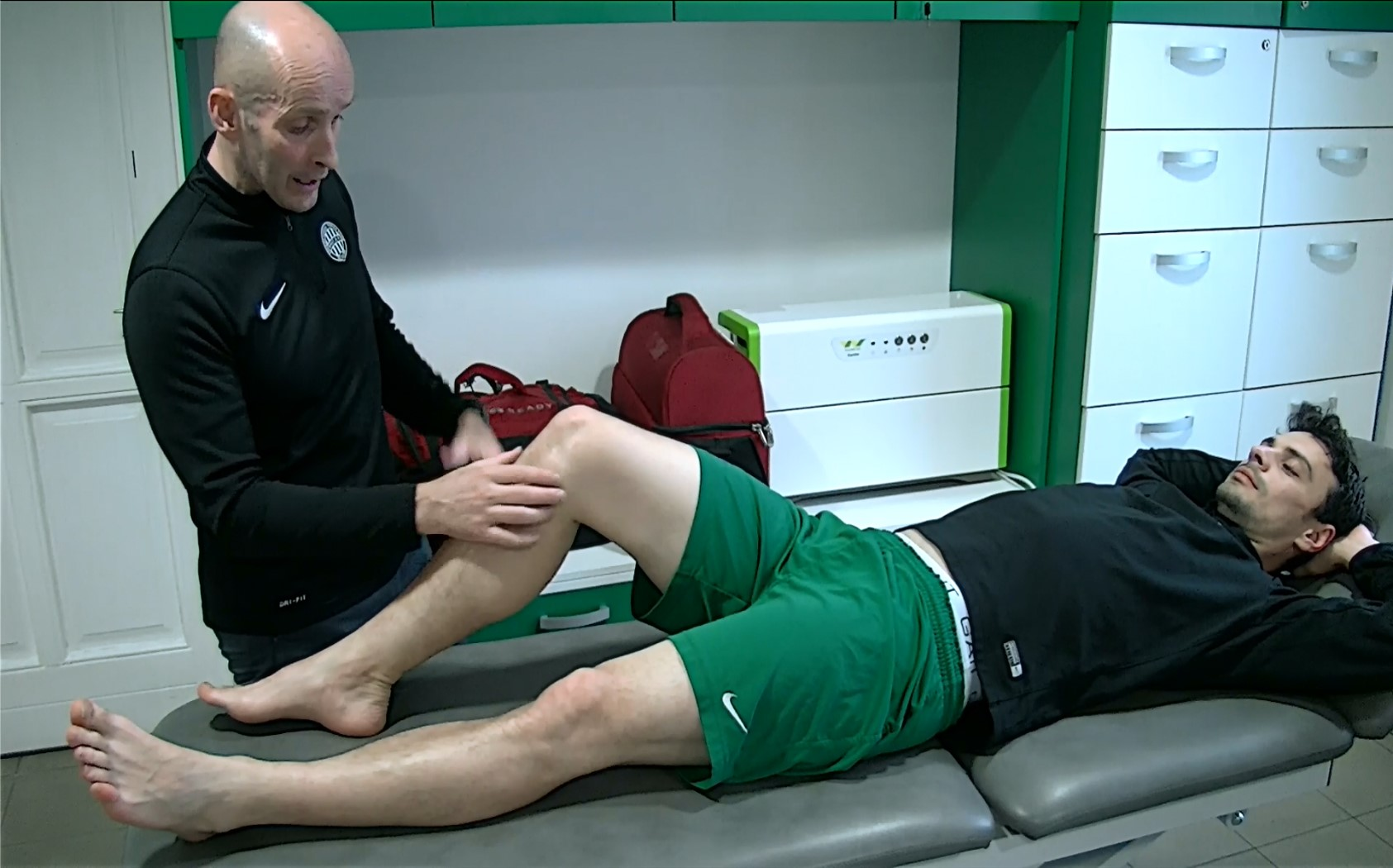 Peter Friar, Physio, examining professional football player