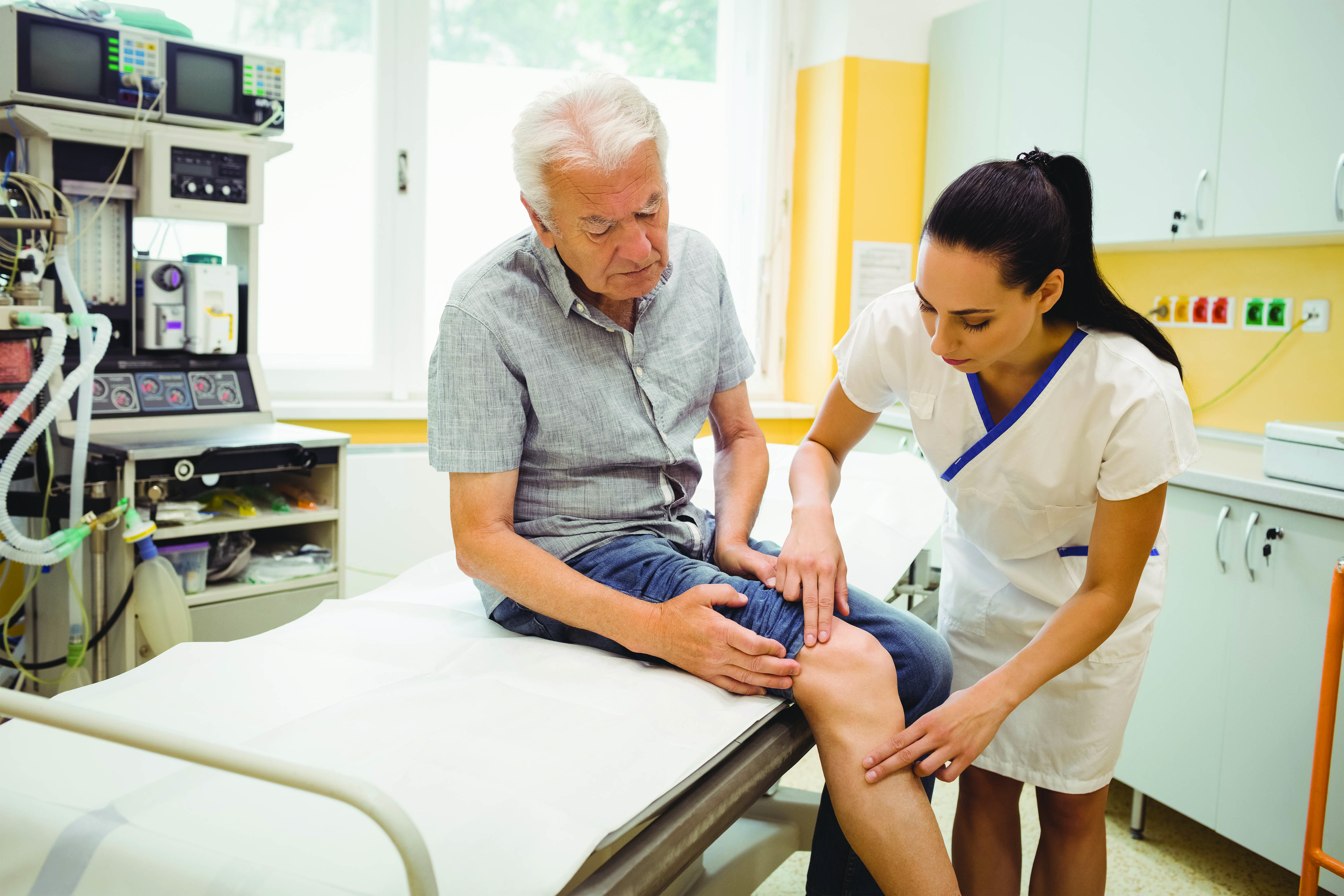Clinician checks patient's knee